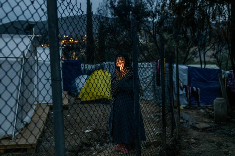 The three camps to be closed currently house over 27,000 people under terrible conditions that have been repeatedly castigated by rights groups (AFP Photo/ANGELOS TZORTZINIS)