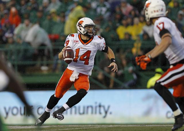 BC Lions quarterback Travis Lulay (14) looks to make the pass while playing against the Saskatchewan Roughriders during the first half of their CFL football game in Regina, Saskatchewan July 17, 2015. REUTERS/David Stobbe