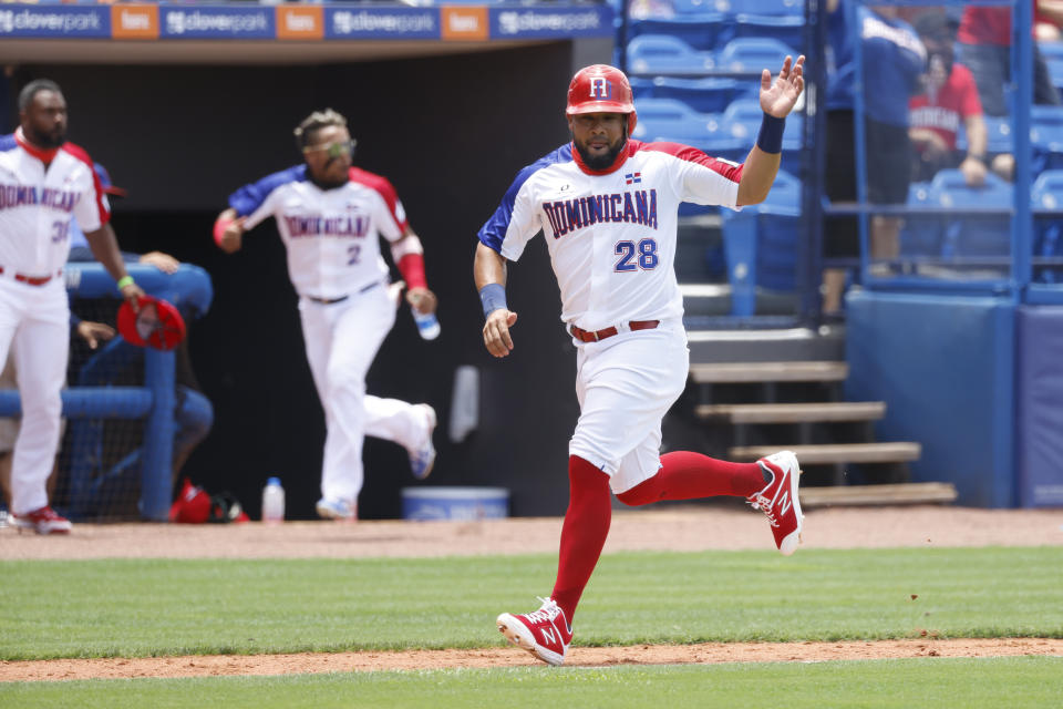 PORT ST. LUCIE, FL - JUNE 05:  Melky Cabrera #28 of Team Dominican Republic celebrates reaching home during the 2021 WBSC Baseball America Qualifier at Clover Park on Saturday, June 5, 2021 in Port St. Lucie, Florida. (Photo by Rhona Wise/MLB Photos via Getty Images)