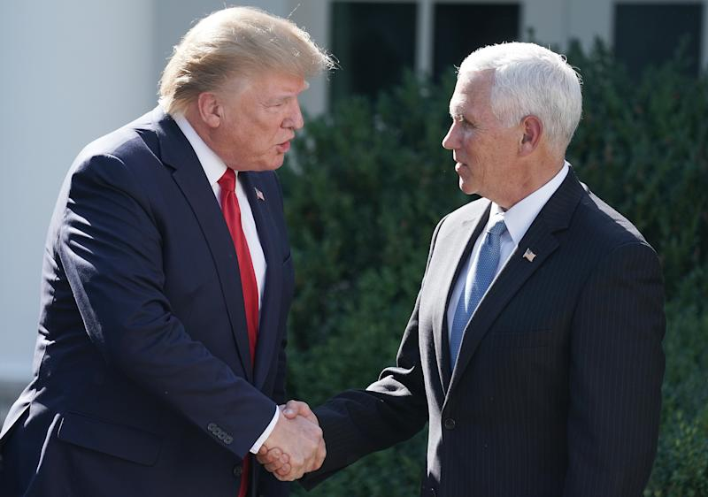 U.S. President Donald Trump (L) shakes hands with Vice President Mike Pence at the White House August 29, 2019 in Washington, D.C. (Photo: Chip Somodevilla/Getty Images)