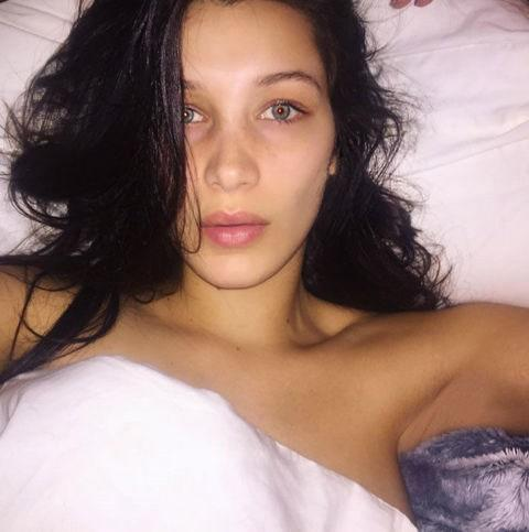 """<a href=""""http://www.glamour.com/story/bella-hadid-platinum-pink-hair-color?mbid=synd_yahoo_rss"""" rel=""""nofollow noopener"""" target=""""_blank"""" data-ylk=""""slk:Platinum pink hair"""" class=""""link rapid-noclick-resp"""">Platinum pink hair</a>. <a href=""""http://www.glamour.com/story/how-to-get-away-with-wearing-your-swimsuit-as-an-actual-shirt?mbid=synd_yahoo_rss"""" rel=""""nofollow noopener"""" target=""""_blank"""" data-ylk=""""slk:Swimsuits as tops"""" class=""""link rapid-noclick-resp"""">Swimsuits as tops</a>. No makeup (and a hair change-up). She works it all."""