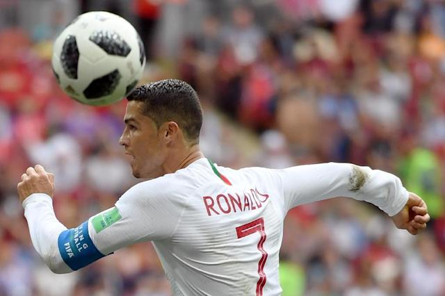 Leading by a head: Cristiano Ronaldo leads the Golden Boot race with four goals (AFP Photo/YURI CORTEZ)
