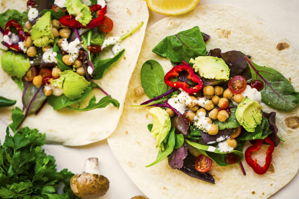 Vegan wraps with salad, chickpeas, vegetables and avocado