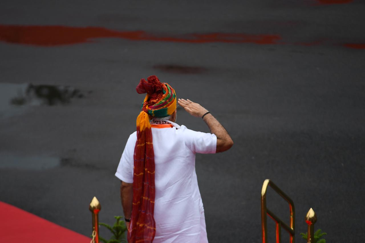 India's Prime Minister Narendra Modi salutes as he reviews a guard of honour during a ceremony to celebrate country's 73rd Independence Day, which marks the of the end of British colonial rule, at the Red Fort in New Delhi on August 15, 2019. (Photo by Money SHARMA / AFP) (Photo credit should read MONEY SHARMA/AFP/Getty Images)