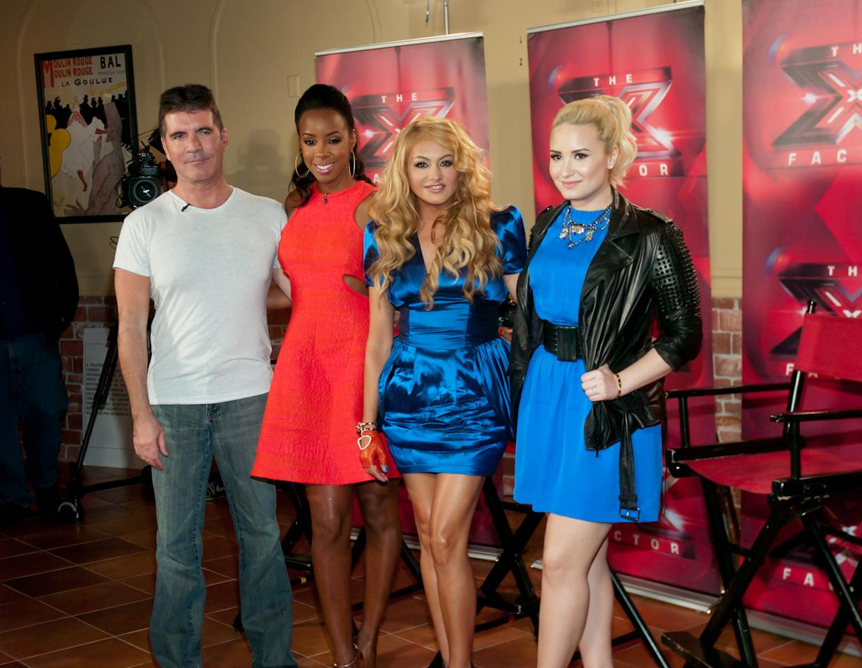 "(L-R) Simon Cowell, Kelly Rowland, Paulina Rubio and Demi Lovato attend the ""The X Factor"" Judges press conference at Nassau Veterans Memorial Coliseum on June 20, 2013 in Uniondale, New York."