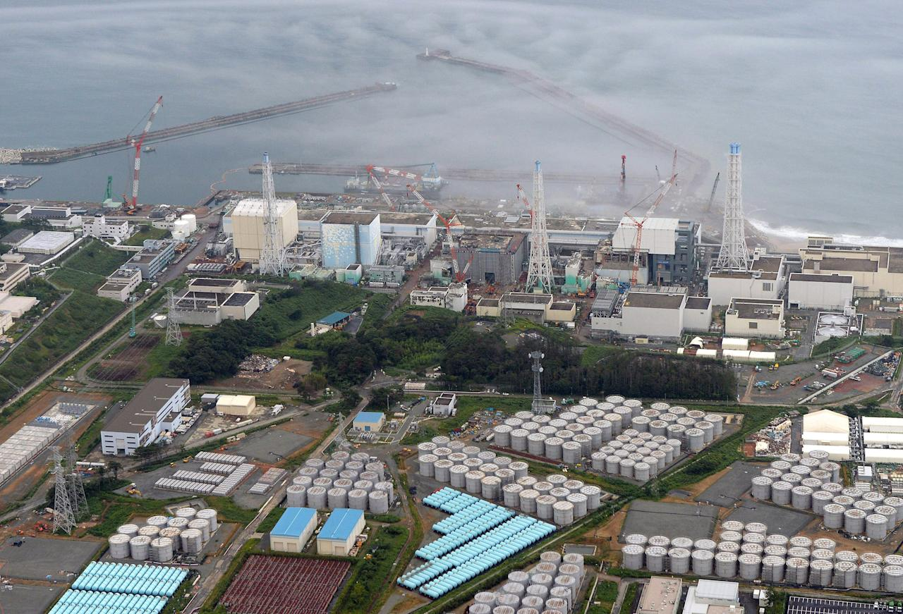 This Tuesday, Aug. 20, 2013 aerial photo shows the Fukushima Dai-ichi nuclear plant at Okuma in Fukushima prefecture, northern Japan. The Japanese nuclear watchdog proposed Wednesday to define a fresh leakage of highly radioactive leak from one of the hundreds of storage tanks at Japan's crippled atomic power plant this week, its worst leak yet from such a vessel. The operator of the Fukushima Dai-ichi plant said Tuesday said about 300 tons (300,000 liters, 80,000 gallons) of contaminated water have leaked from a steel storage tank at the wrecked Fukushima Dai-ichi plant. TEPCO hasn't figured out how or where the water leaked, but suspects it did so through a seam on the tank or a valve connected to a gutter around the tank. (AP Photo/Kyodo News) JAPAN OUT, MANDATORY CREDIT