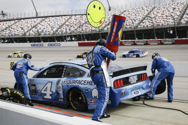 Kevin Harvick (4) makes a pit stop during the NASCAR Cup Series auto race Sunday, May 17, 2020, in Darlington, S.C. (AP Photo/Brynn Anderson)