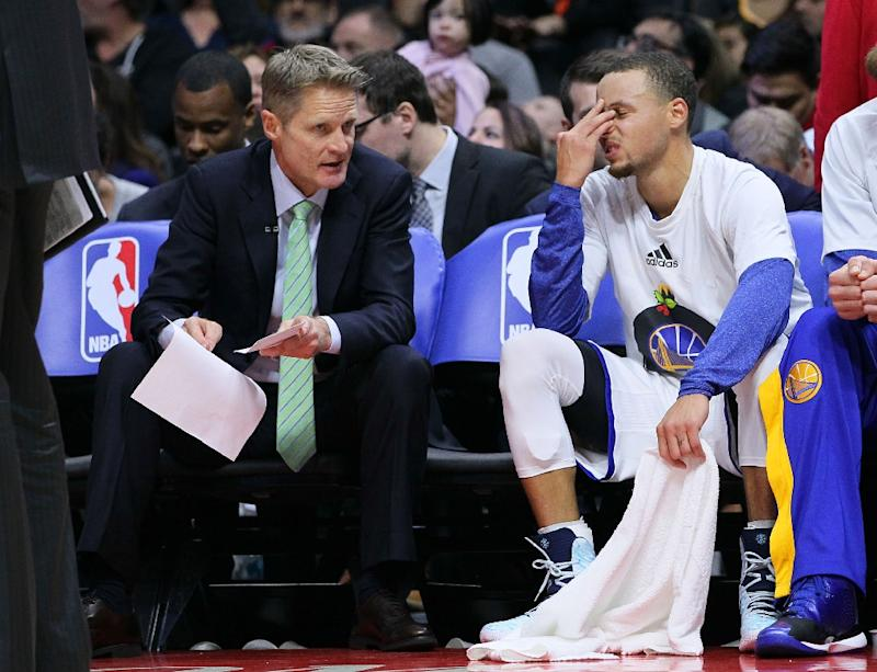 Head Coach Steve Kerr of the Golden State Warriors has a word with Stephen Curry during a NBA game at Staples Center in Los Angeles, California, on December 25, 2014