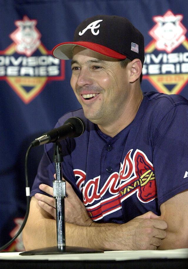 FILE - In this Oct. 8, 2001 file photo, Atlanta Braves pitcher Greg Maddux smiles as he answers a question during a news conference in Houston. Maddux, Tom Glavine and Frank Thomas have been elected to baseball's Hall of Fame. The results were announced Wednesday, Jan. 8, 2014. (AP Photo/David J. Phillip, File)
