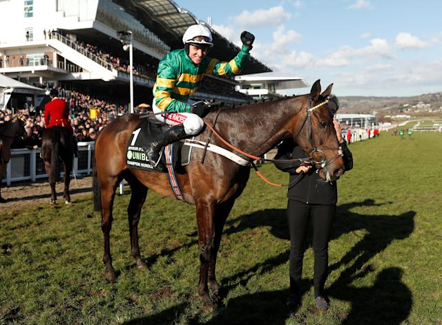 Horse Racing - Cheltenham Festival - Cheltenham Racecourse, Cheltenham, Britain - March 13, 2018 Barry Geraghty celebrates on Buveur D'Air after winning the 15:30 Unibet Champion Hurdle Challenge Trophy Action Images via Reuters/Matthew Childs