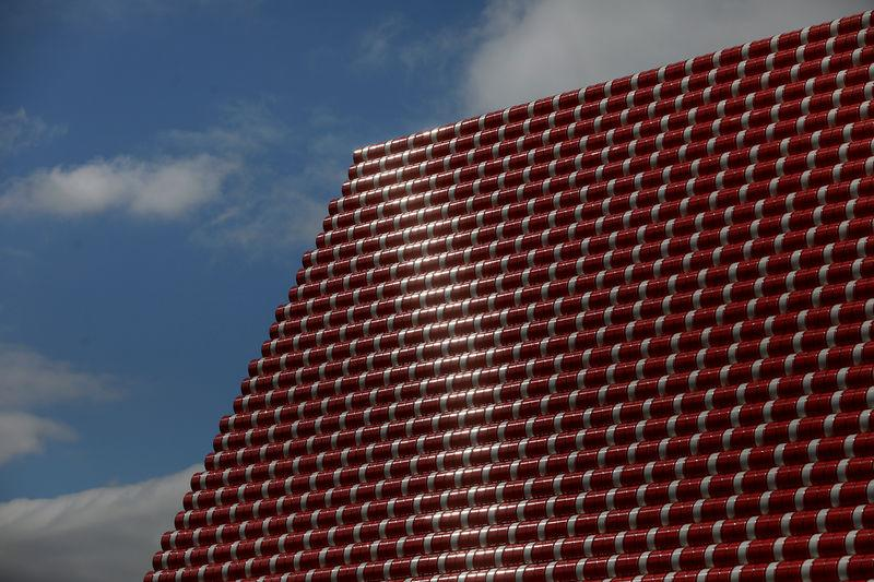 The sun reflects on oil barrels that make up Christo's work The London Mastaba, on the Serpentine in Hyde Park, London, Britain, June 18, 2018. REUTERS/Simon Dawson