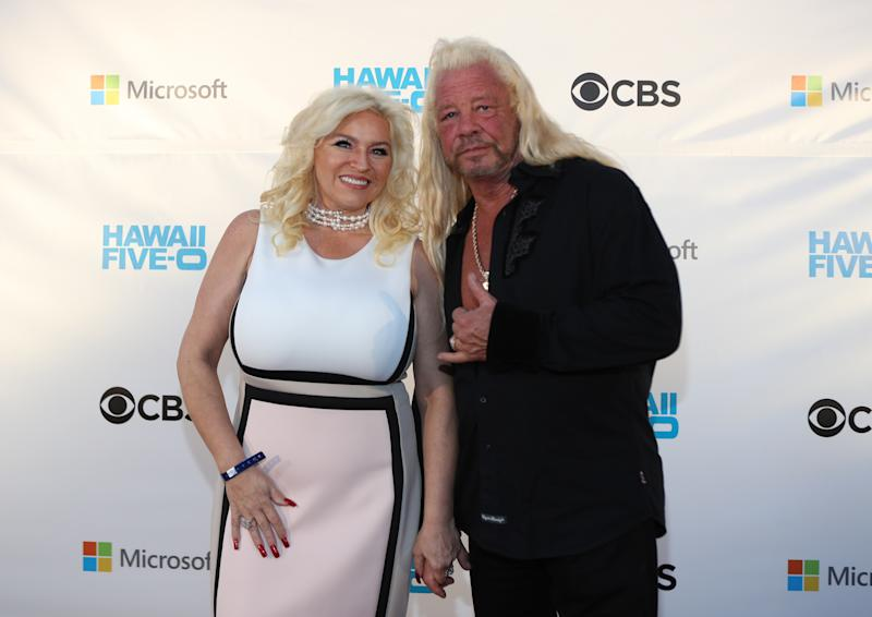 """WAIKIKI, HI - NOVEMBER 10: Beth Chapman (l) and Duane Chapman attend the Sunset on the Beach event celebrating season 8 of """"Hawaii Five-0"""" at Queen's Surf Beach on November 10, 2017 in Waikiki, Hawaii. (Photo by Darryl Oumi/Getty Images)"""