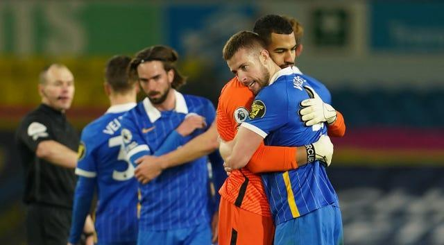 Brighton's players hugged on the pitch at the end of their 1-0 win over Leeds.