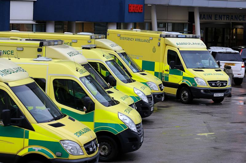 File photo dated 04/01/18 of ambulances outside a hospital. Ambulance crews are being fined for driving in bus lanes, and banned from public transport lanes when not on a 999 emergency, according to their union.