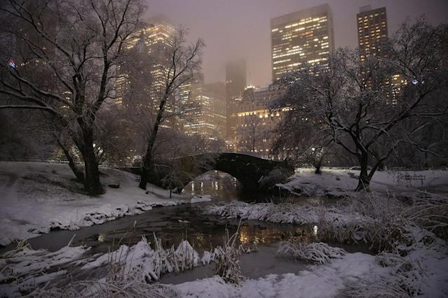 <p>The Gapstow Bridge in Central Park is seen with midtown Manhattan in the background as a winter storm passes through the area, dumping 7 to 11 inches of the white stuff on March 7, 2018. (Photo: Gordon Donovan/Yahoo News) </p>