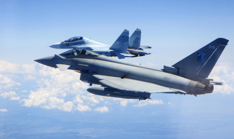 CAPTION CORRECTS AIRCRAFT NAME - In this photo  taken on Saturday, June 15, 2019, a Royal Air Force Typhoon jet, foreground, flies by a Su-30 Flanker fighter. Two Royal Air Force jets deployed in Estonia have been scrambled twice in recent days, bringing the number of intercepts of Russian aircraft to eight since taking over the Baltic Air Policing mission in early May. The Typhoon jets were alerted Friday to intercept a Russian Su-30 Flanker fighter, and passed a military transport craft as it was escorting the fighter over the Baltic Sea. In a second incident on Saturday, RAF crews intercepted a Su-30 Flanker fighter and an Ilyushin Il-76 Candid transport aircraft that was traveling north from the Russian enclave of Kaliningrad toward Estonian and Finnish airspace. (UK Ministry of Defence via AP)