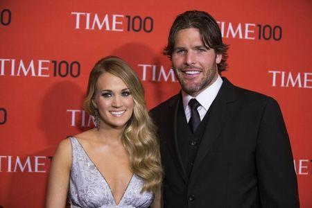 Underwood arrives with her husband Fisher at the Time 100 gala celebrating the magazine's naming of the 100 most influential people in the world for the past year, in New York