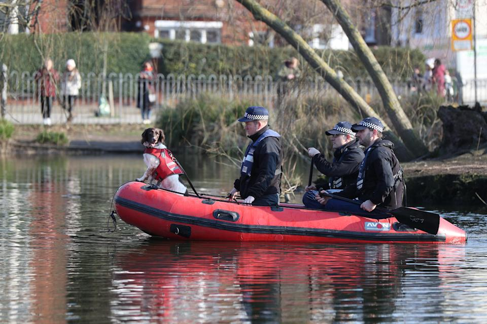 Police in a RIB with a sniffer dog search Eagle Pond on Clapham Common for missing woman Sarah Everard, 33, who left a friend's house in Clapham, south London, on Wednesday evening at around 9pm and began walking home to Brixton. Picture date: Sunday March 7, 2021.