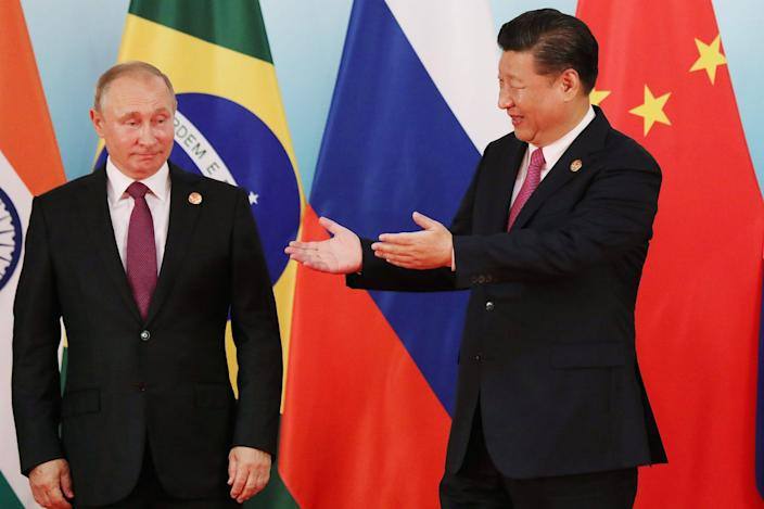 Chinese President Xi Jinping with Russian President Vladimir Putin at the BRICS Summit in southeastern China's Fujian Province, September 4, 2017.