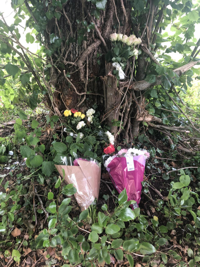 Floral tributes at the scene of a crash on Abbey Road, Dalton-in-Furness, Cumbria, on Sunday that left three members of the same family dead (PA)