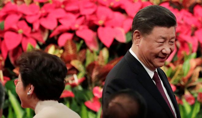Chinese President Xi Jinping and Hong Kong Chief Executive Carrie Lam attend a ceremony in Macau on December 20 to celebrate the 20th anniversary of the casino hub's return to China. Photo: Reuters