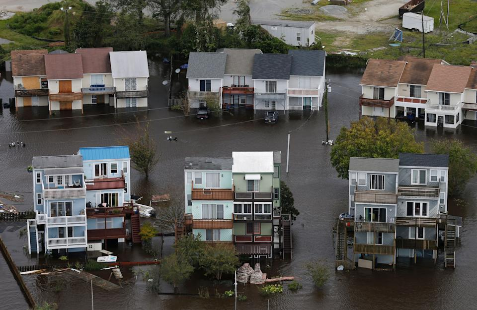 Homes along the New River are flooded in Jacksonville, North Carolina.