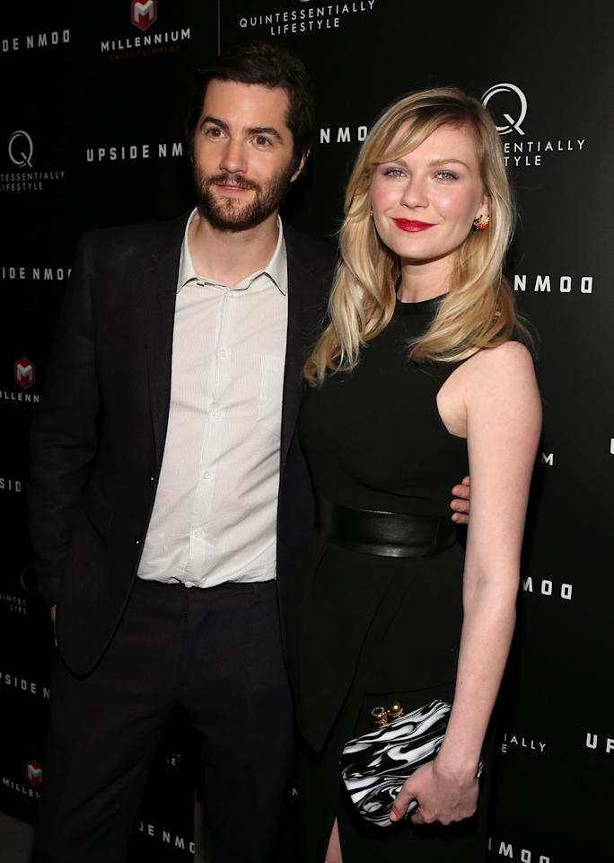 "HOLLYWOOD, CA - MARCH 12:  Actors Jim Sturgess (L) and Kirsten Dunst attend the screening of Millennium Entertainment's ""Upside Down"" at ArcLight Hollywood on March 12, 2013 in Hollywood, California.  (Photo by Christopher Polk/Getty Images)"
