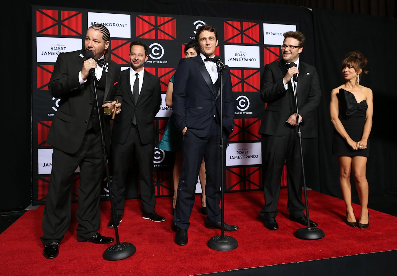 """Jeff Ross, actor Nick Kroll, roastee James Franco, roast master Seth Rogen, and Natasha Leggero speak onstage in the press room at """"The Comedy Central Roast of James Franco"""" at Culver Studios on August 25, 2013 in Culver City, California."""