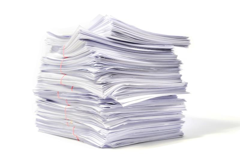 Stack Of Papers Against White Background