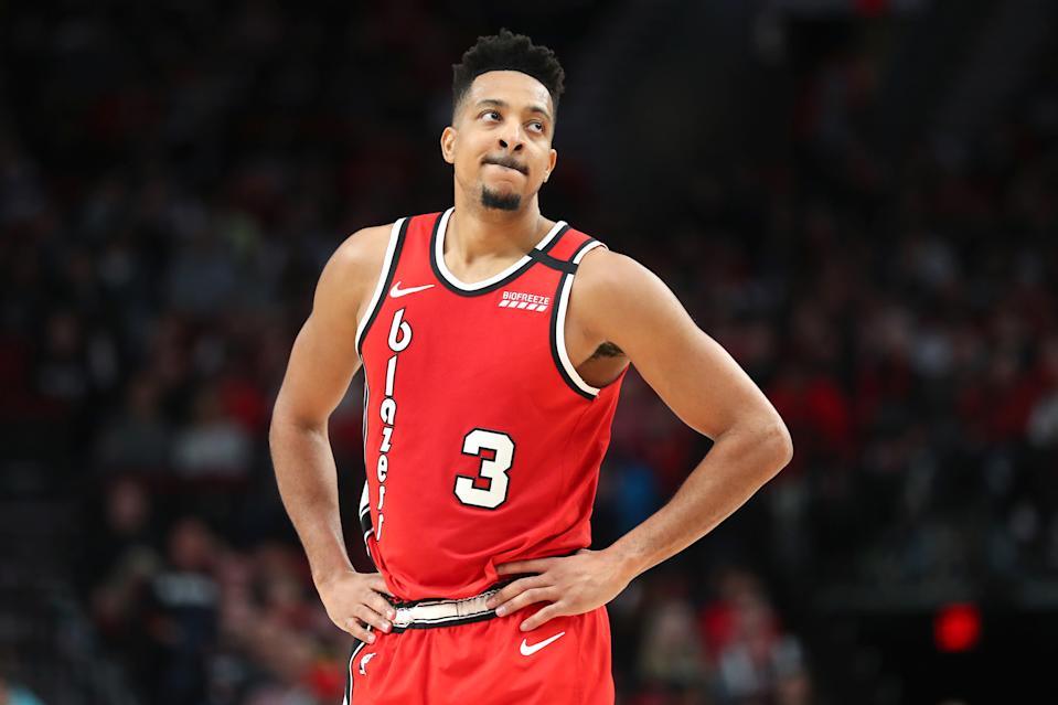 CJ McCollum #3 of the Portland Trail Blazers reacts in the third quarter against the Detroit Pistons during their game at Moda Center on February 23, 2020 in Portland, Oregon. NOTE TO USER: User expressly acknowledges and agrees that, by downloading and or using this photograph, User is consenting to the terms and conditions of the Getty Images License Agreement. (Photo by Abbie Parr/Getty Images)