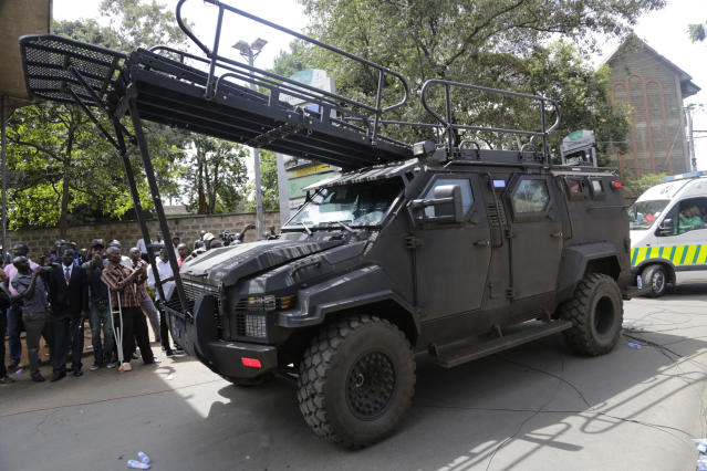 Members of Kenyan special forces at the scene of an attach by an extremist gunmen Wednesday, Jan. 16, 2019 in Nairobi, Kenya. Extremists stormed a luxury hotel in Kenya's capital on Tuesday, setting off thunderous explosions and gunning down people at cafe tables in an attack claimed by Africa's deadliest Islamic militant group.(AP Photo/Khalil Senosi)