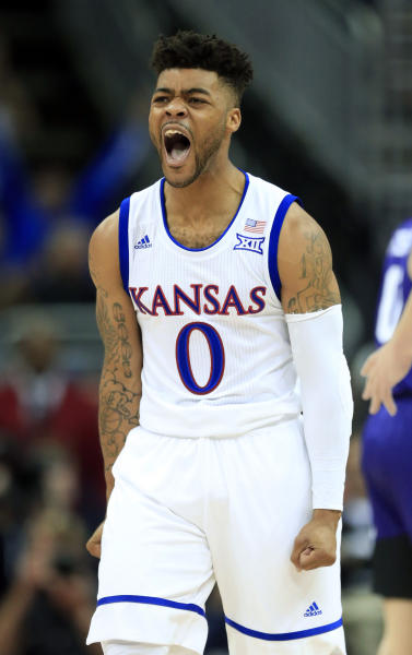 Kansas guard Frank Mason III (0) screams after a basket during second half of an NCAA college basketball game against TCU in the quarterfinal round of the Big 12 tournament in Kansas City, Mo., Thursday, March 9, 2017. TCU defeated Kansas 85-82. (AP Photo/Orlin Wagner)