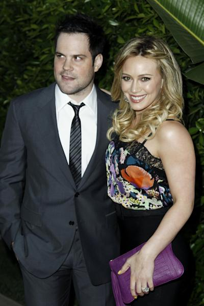 """FILE - In this May 11, 2011 file photo, Hilary Duff, right, and Mike Comrie arrive at an Evening of """"Southern Style"""" presented by The St. Bernard Project and the Spears Family in Beverly Hills, Calif. Duff and her husband Comrie are calling it quits after three years or marriage according to Duff's reps. on Friday, Jan. 10, 2014. (AP Photo/Matt Sayles, File)"""