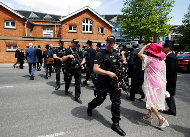 Horse Racing - Royal Ascot - Ascot Racecourse, Ascot, Britain - June 21, 2018 Racegoers with police officers before the start of the racing REUTERS/Peter Nicholls