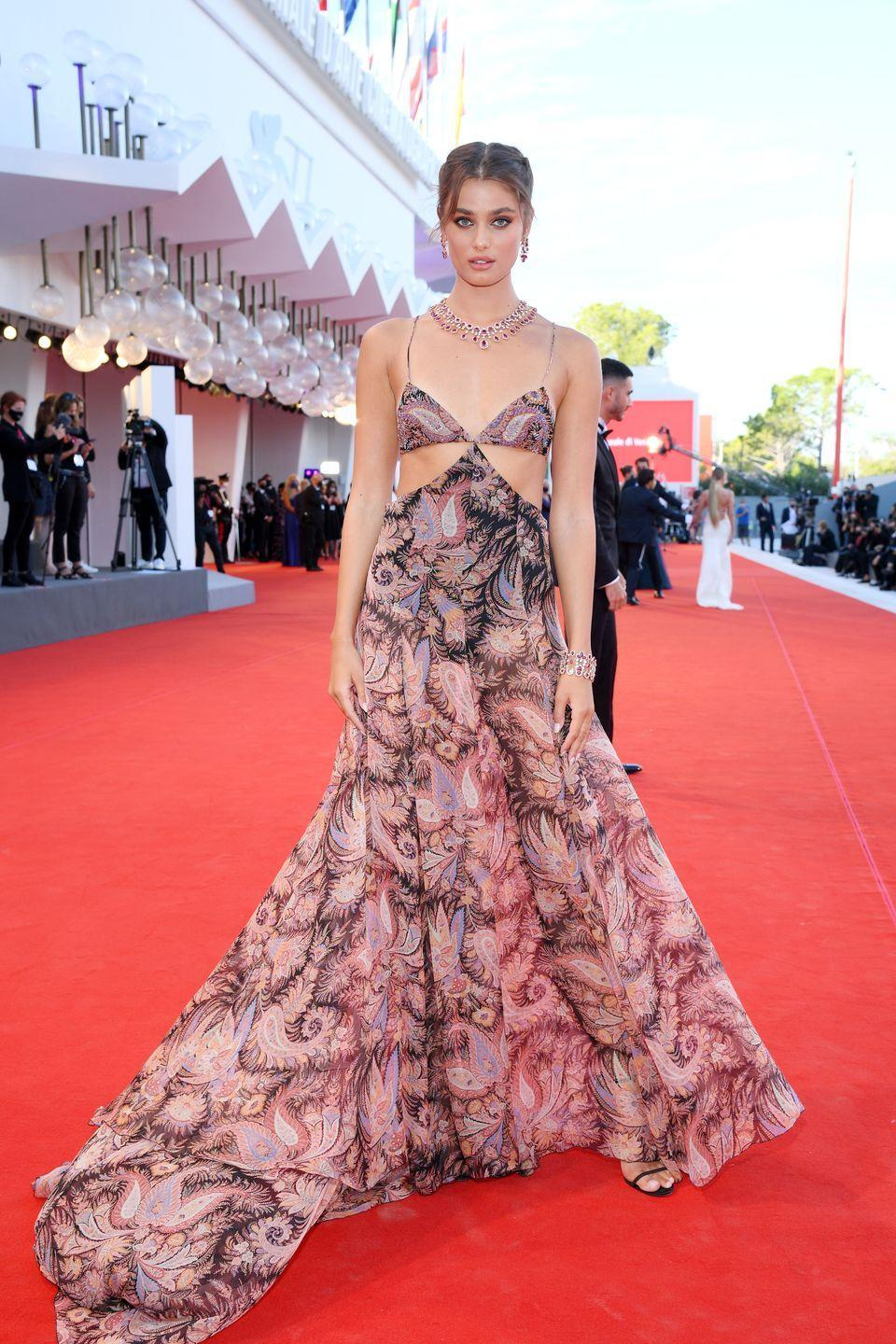 <p>Taylor Hill wears a paisley-printed dress by Etro and bold jewelry by Chopard. </p>