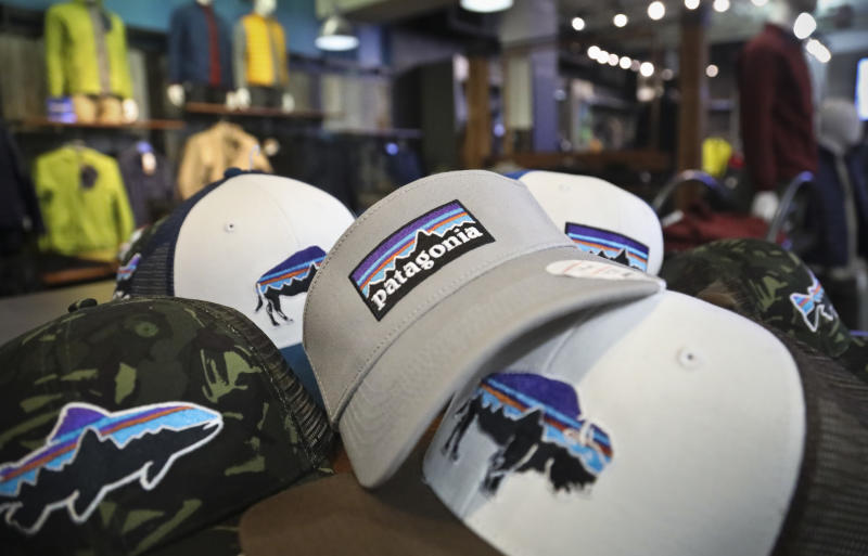 This photo shows the Patagonia logo on items in the brand section of a retail department store Wednesday, Nov. 28, 2018, in New York. Patagonia, an outdoor gear company, is passing along the $10 million it saved from tax cuts to non-profit environmental groups. (AP Photo/Bebeto Matthews)