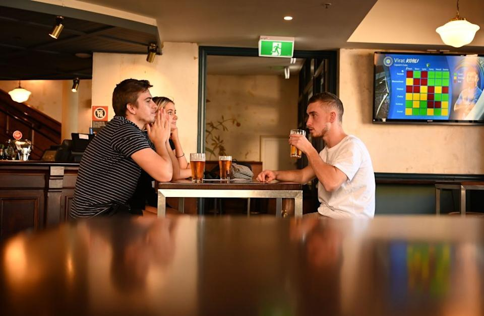 Patrons drink beer at a pub in the Rocks area of Sydney on June 1, after social distancing measures were eased. Source: Getty Images
