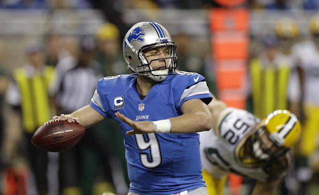 Detroit Lions quarterback Matthew Stafford (9) throws during the first quarter of an NFL football game against the Green Bay Packers at Ford Field in Detroit, Thursday, Nov. 28, 2013. (AP Photo/Carlos Osorio)