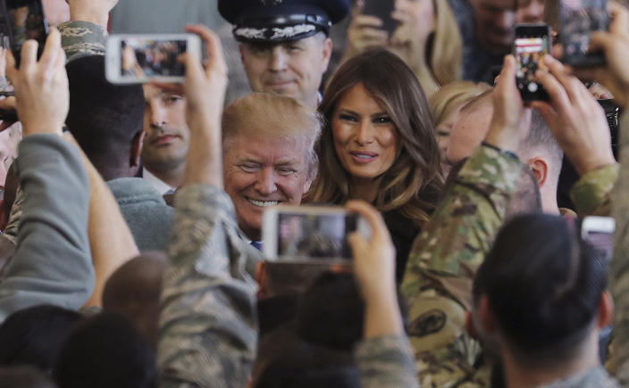"""<p>President Donald Trump and First Lady Melania Trump are surrounded by the U.S. military personnel upon his arrival at the U.S. Yokota Air Base on the outskirts of Tokyo, Sunday, Nov. 5, 2017. President Trump praised Japan as """"a treasured partner"""" and """"crucial ally"""" as he kicked off a grueling and consequential first trip to Asia. Trump landed at Yokota Air Base where he was greeted by cheers from gathered servicemembers. (Photo: Eugene Hoshiko/AP) </p>"""