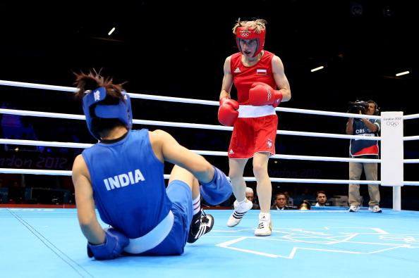 LONDON, ENGLAND - AUGUST 05:  Chunneijang Mery Kom Hmangte of India (L) in action with Karolina Michalczuk of Poland during the Women's Fly (48-51kg) Boxing on Day 9 of the London 2012 Olympic Games at ExCeL on August 5, 2012 in London, England.  (Photo by Scott Heavey/Getty Images)