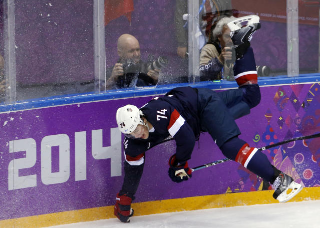 USA forward T.J. Oshie trips against Russia in the first period of a men's ice hockey game at the 2014 Winter Olympics, Saturday, Feb. 15, 2014, in Sochi, Russia. (AP Photo/Petr David Josek)