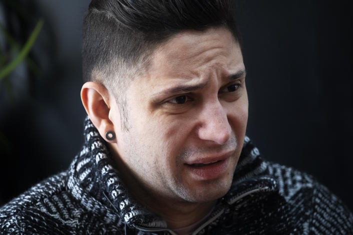 In this Feb. 28, 2020 photo, Venezuelan Kamal Morales discusses the plight of his Venezuelan boyfriend Gustavo Acosta during an interview in New York. Morales' boyfriend has spent the past year moving around U.S. immigrant detention centers in the deep south after they crossed the Mexico-U.S. border together to apply for asylum. Morales' own asylum request was rejected and he was ordered deported, but is currently living in New York while on parole. (AP Photo/Mark Lennihan)