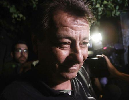 Battisti leaves the headquarters of Federal Police in Sao Paulo