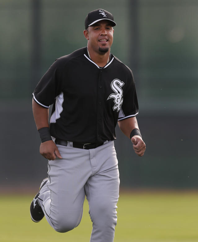 Chicago White Sox's Jose Abreu runs during spring training baseball practice in Glendale, Ariz., Wednesday, Feb. 19, 2014. (AP Photo/Paul Sancya)