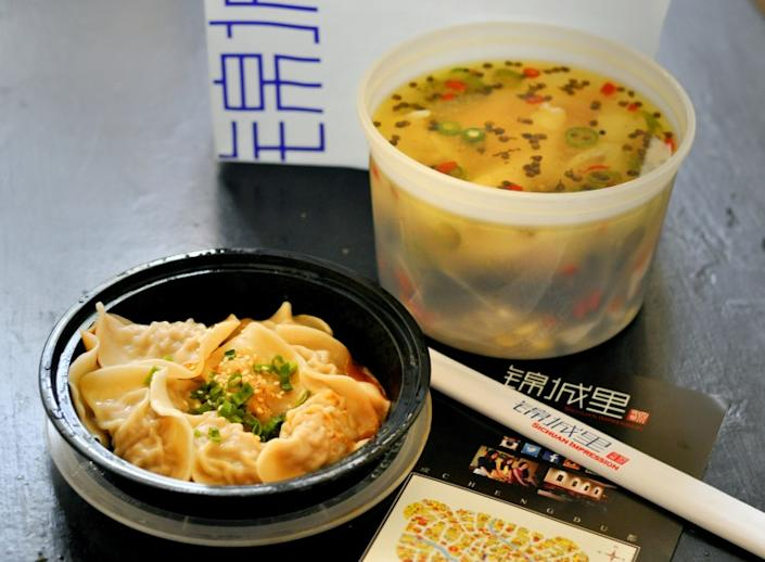 "Some L.A. restaurants don't support capping delivery app fees at 15%. Sichuan Impression is one of the restaurants that signed a petition in opposition to the fee cap. Pictured is an order of boiled fish with rattan pepper and dumplings from the location in Alhambra. <span class=""copyright"">(Amy Scattergood / Los Angeles Times)</span>"