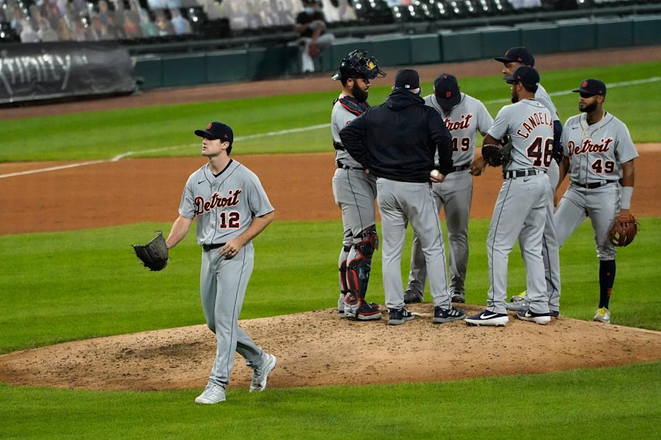 Detroit Tigers starting pitcher Casey Mize (12) heads to the dugout after manager Ron Gardenhire relieved him during the sixth inning of a baseball game against the Chicago White Sox, Friday, Sept. 11, 2020, in Chicago.