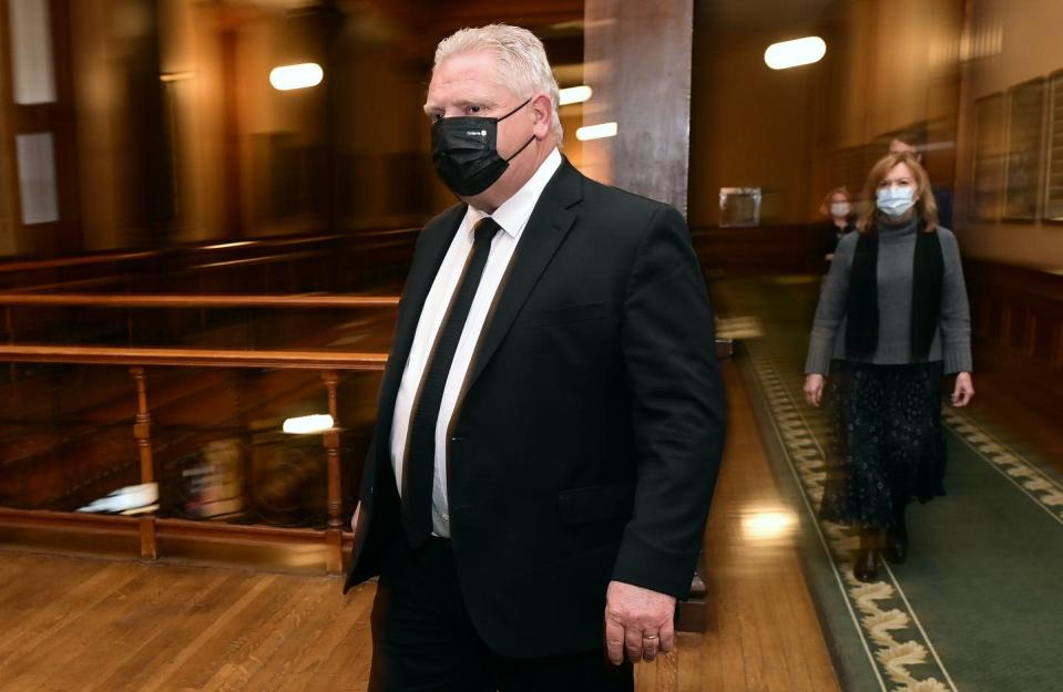 """<span class=""""caption"""">Ontario Premier Doug Ford and Health Minister Christine Elliott walk to a news conference at Queen's Park on April 16, 2021. </span> <span class=""""attribution""""><span class=""""source"""">THE CANADIAN PRESS/Frank Gunn</span></span>"""