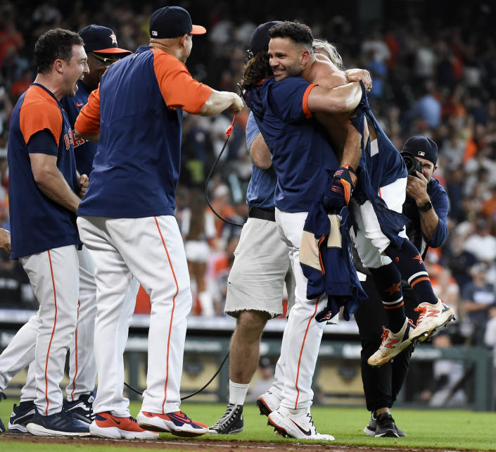 Houston Astros' Jose Altuve, right, celebrates his game-winning three-run home run with Lance McCullers Jr., second from right, and teammates during the ninth inning of a baseball game against the New York Yankees, Sunday, July 11, 2021, in Houston. (AP Photo/Eric Christian Smith)