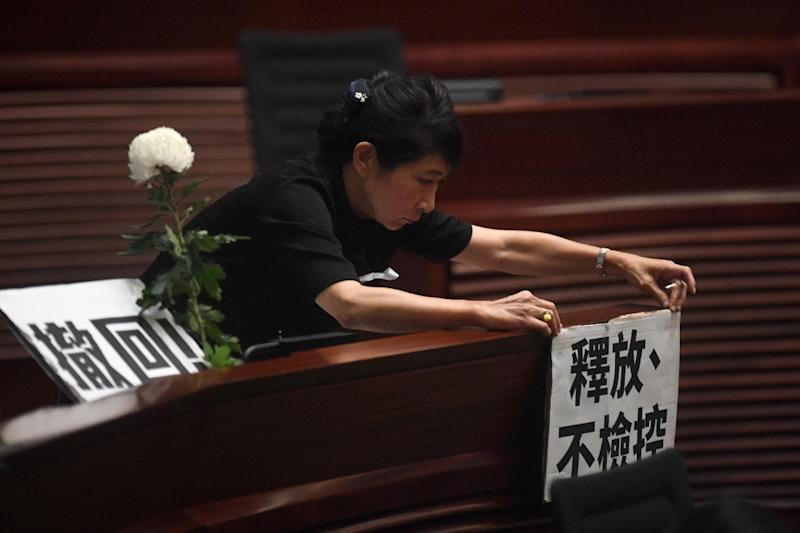 In a tense session, Hong Kong opposition lawmakers criticised the government's handling of the political crisis (AFP Photo/Anthony WALLACE)