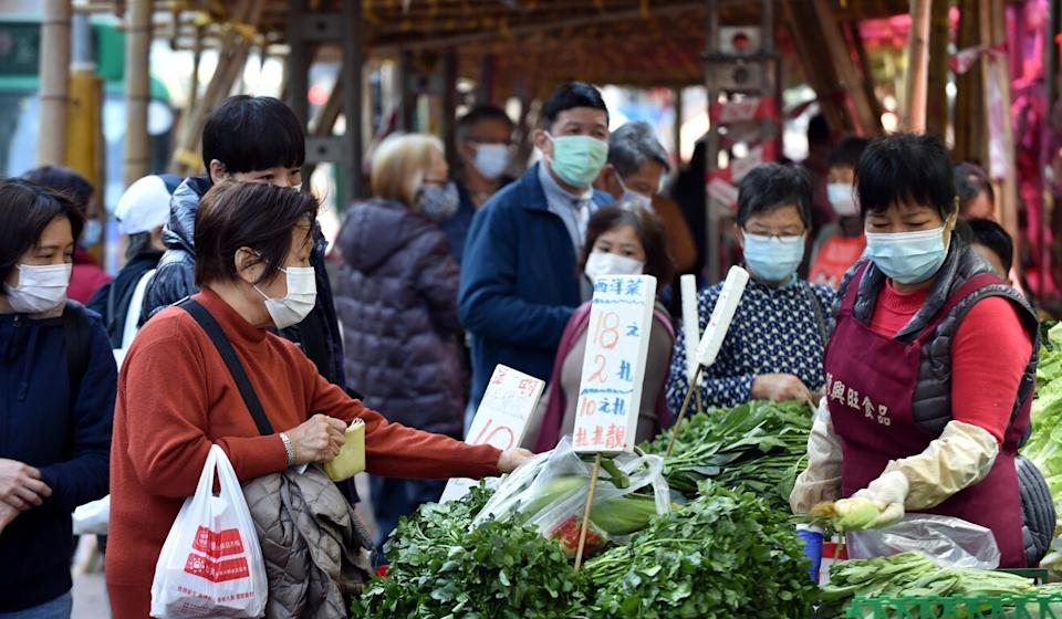 Residents shop for food while wearing masks. Hong Kong has recorded 9,017 confirmed Covid-19 infections and 153 related fatalities. Photo: Xinhua